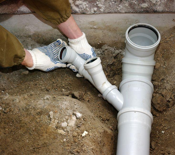 18423934 - plumber assembling pvc sewage pipes